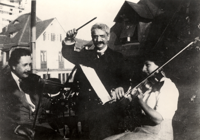 Einstein playing violin with friends